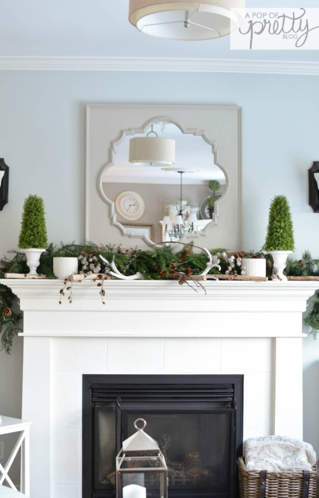 Winter mantel with greenery a pop of pretty blog for Home decorations canada